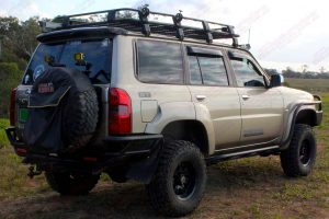 """Rear right end view of the GU Nissan Patrol Wagon fitted with a 3"""" Inch Superior Engineering Remote Reservoir Superflex Lift Kit"""