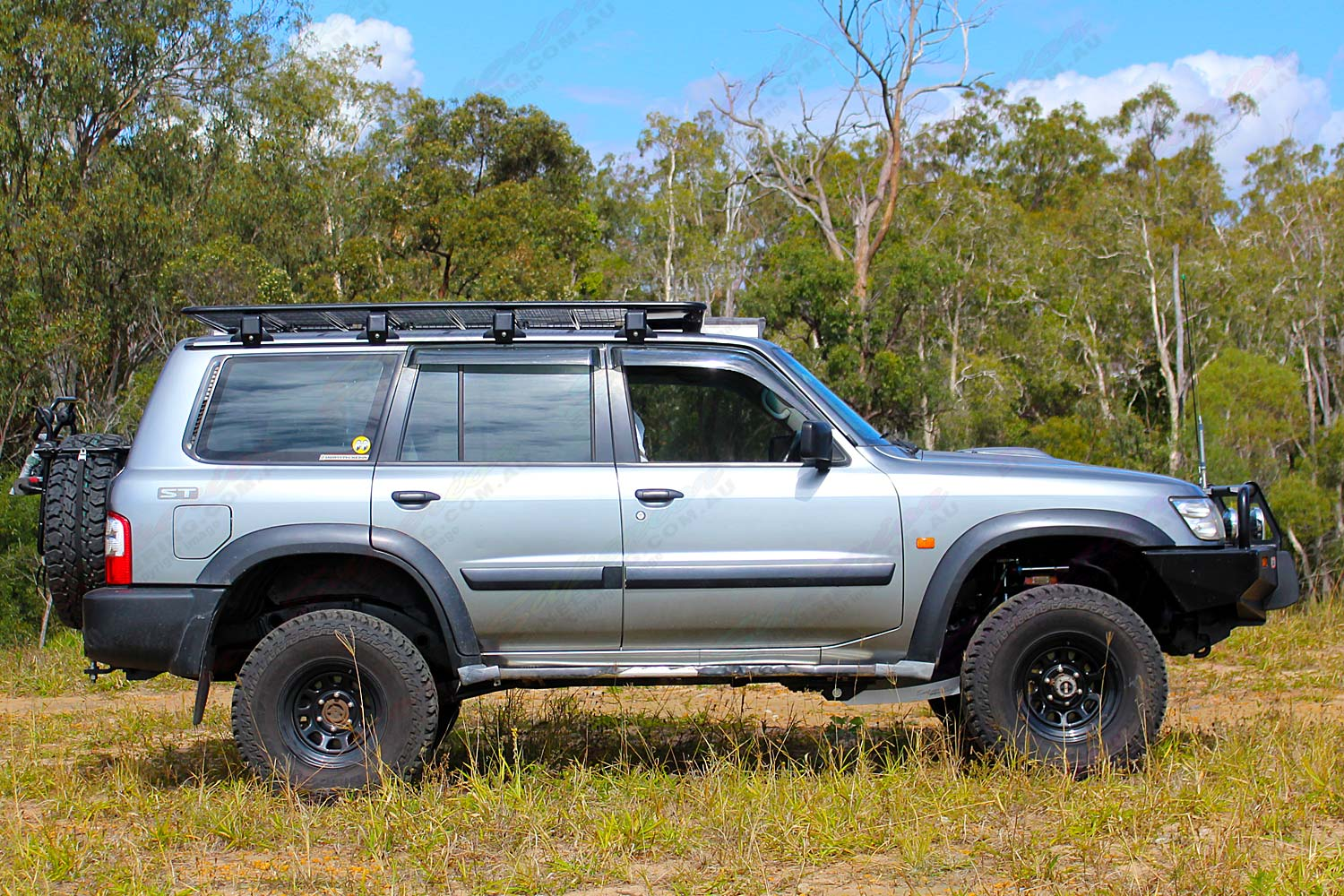 "Right side view of a Silver GU Nissan Patrol Wagon fitted with a 3"" Inch Superior Remote Reservoir Superflex Lift Kit"