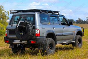 "Rear right side view of a Silver GU Nissan Patrol Wagon fitted with a 3"" Inch Superior Engineering Remote Reservoir Superflex Lift Kit"