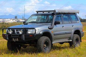 "Front left side view of a Silver GU Nissan Patrol Wagon fitted with a heavy duty 3"" Inch Superior Remote Reservoir Superflex Lift Kit"