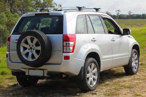 Rear right side view a silver Suzuki Grand Vitara Wagon fitted with an Ironman 4x4 45mm Nitro Gas lift kit