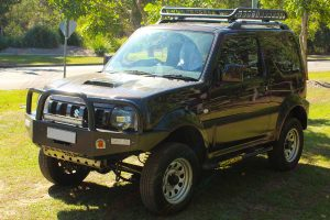 Left side view of the Suzuki Jimny Sierra 4WD after fitting a massive 60mm Tough Dog 4x4 lift kit