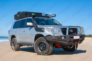 Front right side view of a 200 Series Toyota Landcruiser on the sand fitted out an Ironman 4x4 bullbar, roof top tent, annex, snorkel and winch