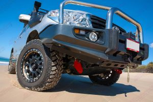 Closeup view of Superior's bash plate and recovery points on the front underside of the 200 Series Toyota Landcruiser