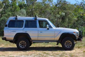 Right side view of a 60 Series Toyota Landcruiser fitted with a heavy duty EFS 2 Inch Lift Kit