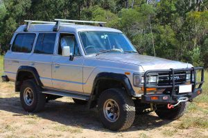 Front right side view of a 60 Series Toyota Landcruiser 4WD fitted with a heavy duty EFS 2 Inch Leaf Spring Lift Kit