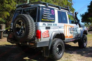 Rear right end view of the silver 76 Series Toyota Landcruiser fitted with a complete range of Superior 4WD accessories and suspension parts