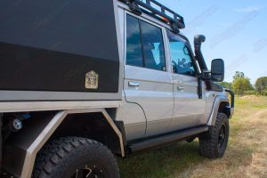 Right side of a fully kitted out 79 Series Toyota Landcruiser (Dual Cab) fitted with new Superior Engineering Stealth Rock Sliders