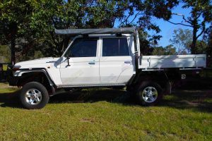 Left side view of a 79 Series Toyota Landcruiser dual cab fitted with a heavy duty Superior 4 Inch Dropped Radius Arm Lift Kit