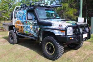 Front right view of the Top of Down Under 79 Series Toyota Landcruiser fitted with Ironman and Superior 4WD accessories and suspension parts