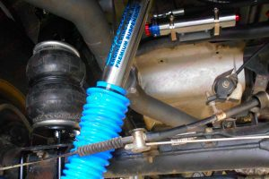 Closeup view of a superior shock, airbag and reservoir fitted to the 76 series Toyota Landcruiser