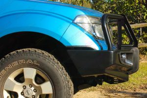 Closeup side view of an Ironman 4x4 Deluxe Black Commercial Bullbar fitted onto the front of a D40 Nissan Navara