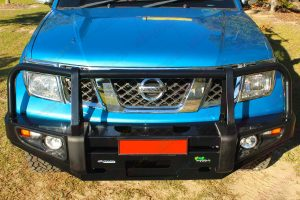 Top closeup view of an Ironman 4x4 Deluxe Black Commercial Bullbar fitted onto the front of a D40 Nissan Navara