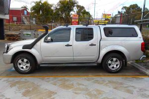 Left side view of a silver D40 Nissan Navara dual cab fitted with an Ironman 4x4 Airforce Snorkel