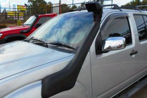 Closeup view of an Ironman 4x4 Airforce Snorkel fitted to a silver D40 Nissan Navara dual cab