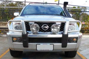Full front view of a silver D40 Nissan Navara dual cab fitted with a Ironman 4x4 Airforce Snorkel