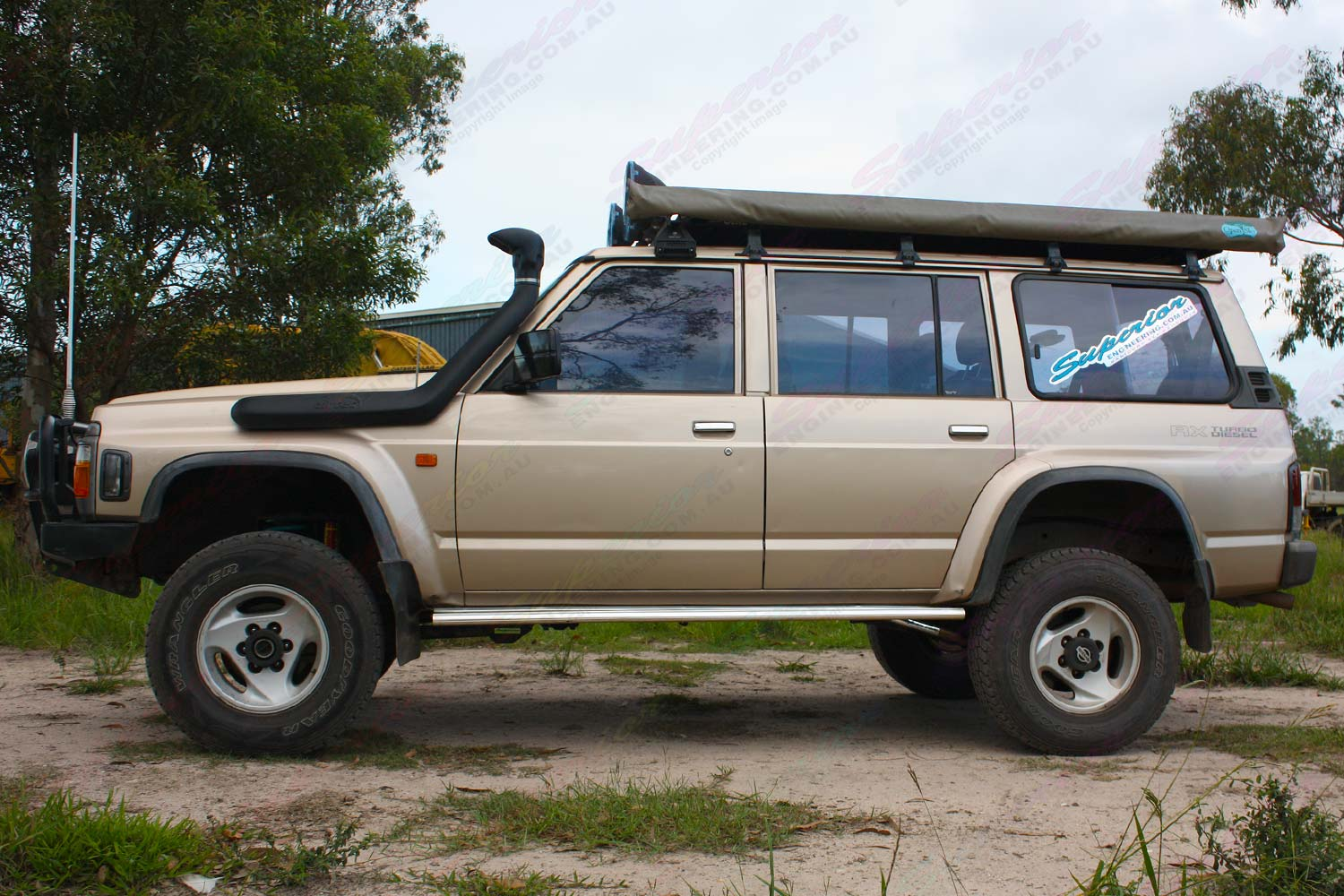 Left side view of a GQ Nissan Patrol wagon after being fitted with Tough Dog shock absorbers, Dobinsons coil springs and Superior control arms, draglink and panhard rod