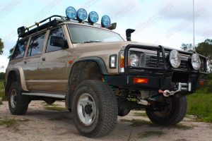 Front right angle view of a GQ Nissan Patrol wagon after being fitted with Tough Dog shock absorbers, Dobinsons coil springs and Superior control arms, draglink and panhard rods