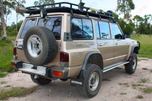 Rear right end view of a GQ Nissan Patrol wagon after being fitted with Tough Dog shock absorbers, Dobinsons coil springs and Superior control arms, draglink and panhard rods