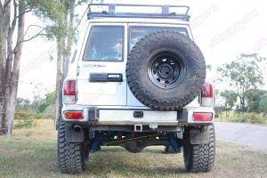 Back view of a GQ Nissan Patrol wagon after being fitted with a Superior Remote Reservoir Superflex 5 Inch Lift Kit