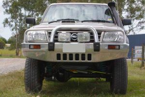 Full front view of a GU Nissan Patrol single cab ute after being fitted with a heavy duty 4 inch Superior Superflex lift kit