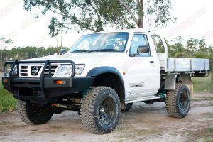 Front left view of a white GU Nissan Patrol single cab ute after being fitted with a 4 inch Superior Drop Box lift kit