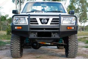 Full front view of a GU Nissan Patrol ute after being fitted with a heavy duty 4 inch Superior Drop Box lift kit