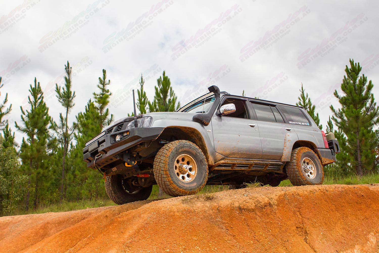 Left side view of a GU Nissan Patrol on the top of a dirt hill at one of the local Glasshouse Mountains four wheel drive tracks