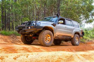 Left side view of a GU Nissan Patrol sitting on top of some dirt ruts at one of the local Glasshouse Mountains four wheel drive tracks
