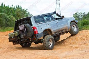 Rear right view of MR Y61's Nissan Patrol front flexing showing off the amount of flex available by fitting the Superior Superflex Radius Arms, Swaybars and Suspension components