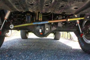 Closeup under vehicle view of the heavy duty adjustable rear Superior panhard rod fitted to the GU Nissan Patrol wagon