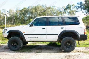 Left side view of a white GU Nissan Patrol wagon after being fitted with a 5 inch EFS Extreme lift kit