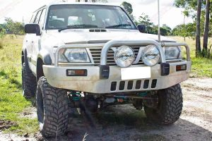 Full front view of a white GU Nissan Patrol wagon after being fitted with a heavy duty 5 inch EFS Extreme lift kit