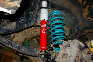 Closeup view of a single EFS Extreme shock and coil spring fitted to the front of a GU Nissan Patrol wagon