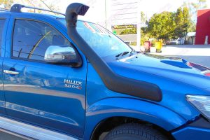Closeup view of the Ironman 4x4 Airforce Snorkel fitted to a blue dual cab Toyota Hilux