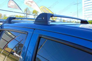 Closeup view of the Whispbar Flush Roof Rack system fitted to the roof of a blue dual cab Toyota Hilux
