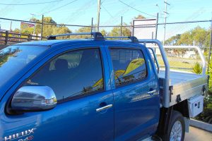 Left side view of the Whispbar Flush Bar Roof Rack system fitted to the roof of the dual cab Toyota Hilux