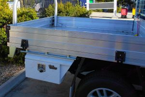 Right side view of the lockable Ironman 4x4 under tray toolbox fitted to the dual cab Toyota Hilux