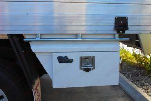 Closeup view of the left hand side, lockable Ironman 4x4 under-tray toolbox fitted to the dual cab Toyota Hilux