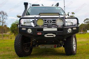 Full front view of the dual cab Toyota Hilux fitted with a 2 inch Bilstein Suspension kit, Superior upper control arms and swaybar relocation plate