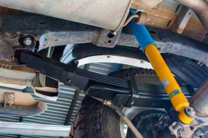 Closeup view the Bilstein shock absorber and leaf springs fitted to the rear of the Toyota Hilux