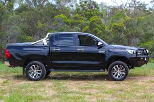 Right side view of a black Toyota Hilux Revo (Dual Cab) fitted with a premium Bilstein 2 inch lift kit