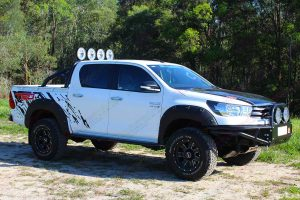 Right side view of a Toyota Hilux Revo (dual cab) fitted with premium Lightforce HID LEDs, Ironman 4x4 side steps, sportsbar, flood lights and GME Antenna - by Superior Engineering