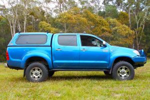 Right side view of a blue dual cab Toyota Hilux (Vigo) fitted with a top of the range 3 inch Bilstein lift kit