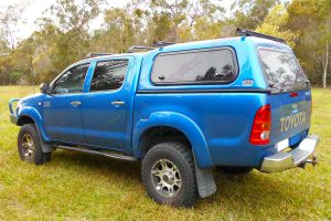 Left rear end view of a blue dual cab Toyota Hilux (Vigo) fitted with a top of the range 3 inch Bilstein lift kit