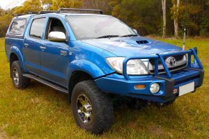 Front right angle view of a blue dual cab Toyota Hilux (Vigo) fitted with a top of the range 3 inch Bilstein lift kit