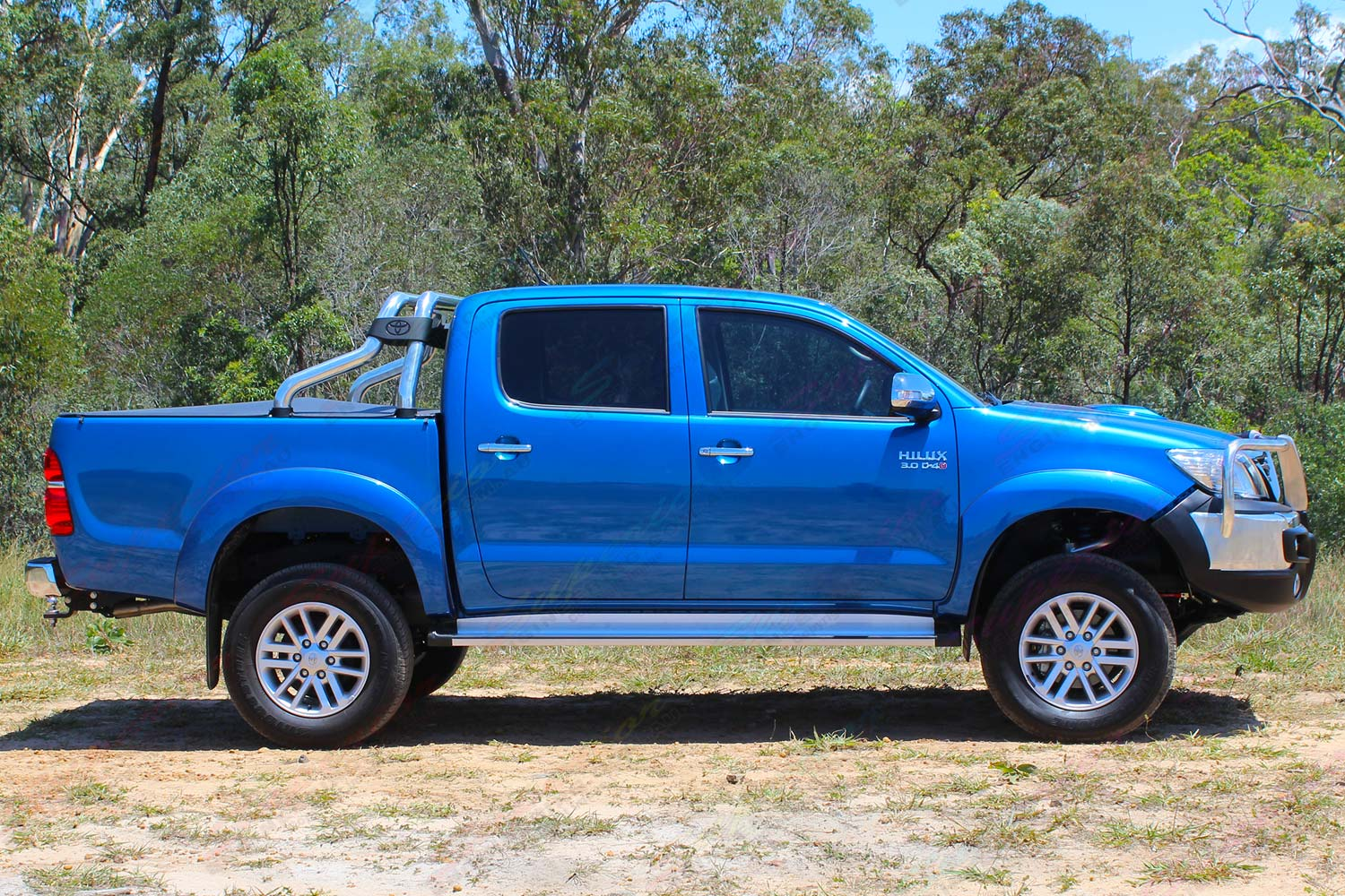 Right side view of a blue dual cab Toyota Hilux (Vigo) fitted with a premium 3 inch Bilstein lift kit