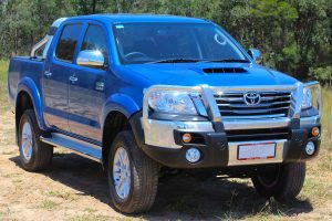 Front right angle view of a blue dual cab Toyota Hilux (Vigo) fitted with a premium 3 inch Bilstein lift kit