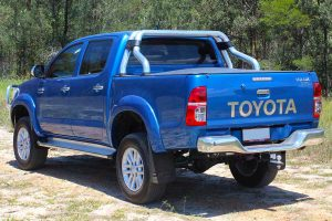 Rear left back view of a blue dual cab Toyota Hilux (Vigo) fitted with a premium 3 inch Bilstein lift kit