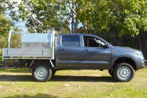 Right side view of a grey dual cab Toyota Hilux (Vigo) fitted with a heavy duty Dobinson 2 inch lift kit